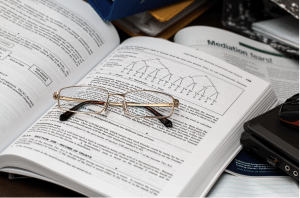 cna resume - open book with reading glasses