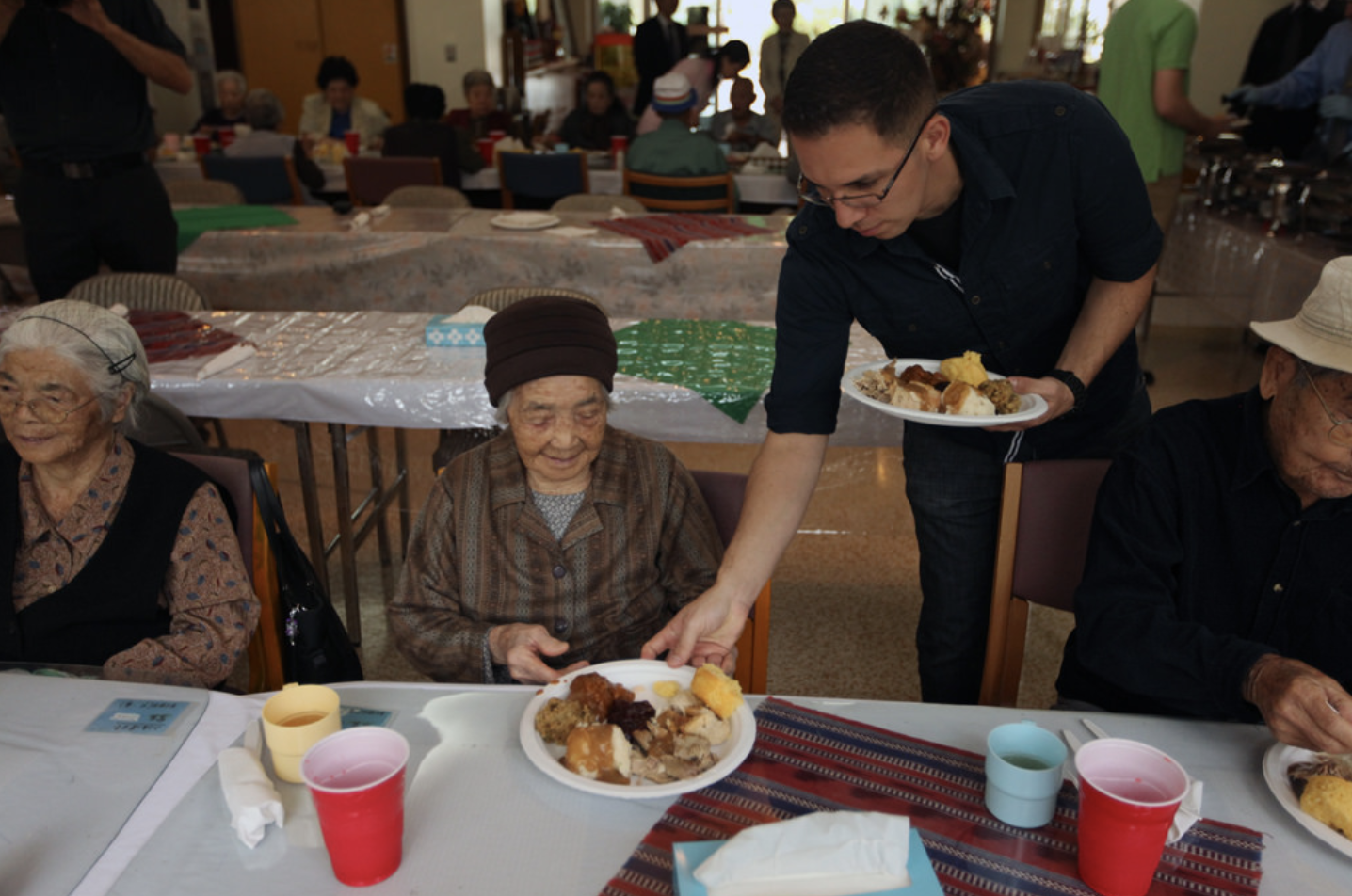 caregiver duties-nurse giving meal to elderly