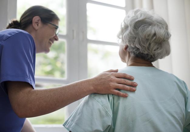 older woman talking to nurse