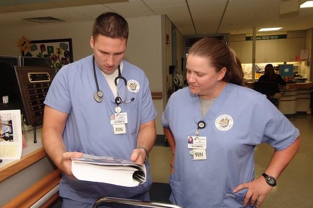 nurses looking at a book