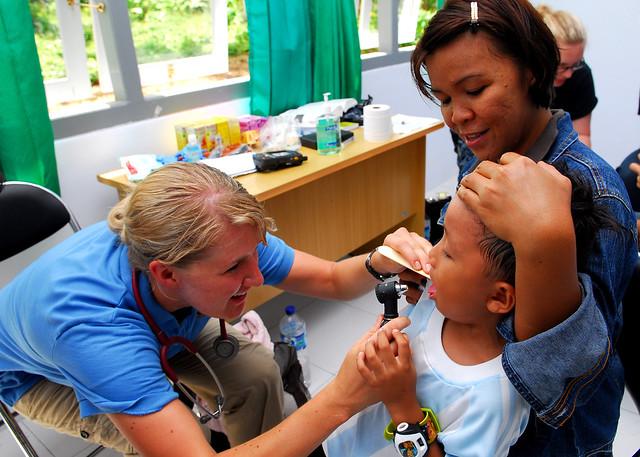 nurse checking a kid
