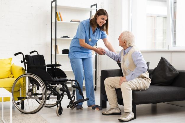 nurse helping old patient